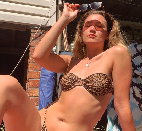 blonde beach girl in leopard print bikini shares what it means to be a lady