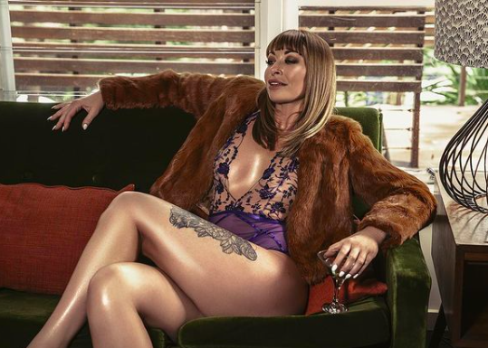 brunette woman in fur and lingerie shares opinion on what it means to be a lady